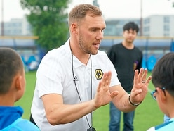 Wolves coach lends his expertise in China
