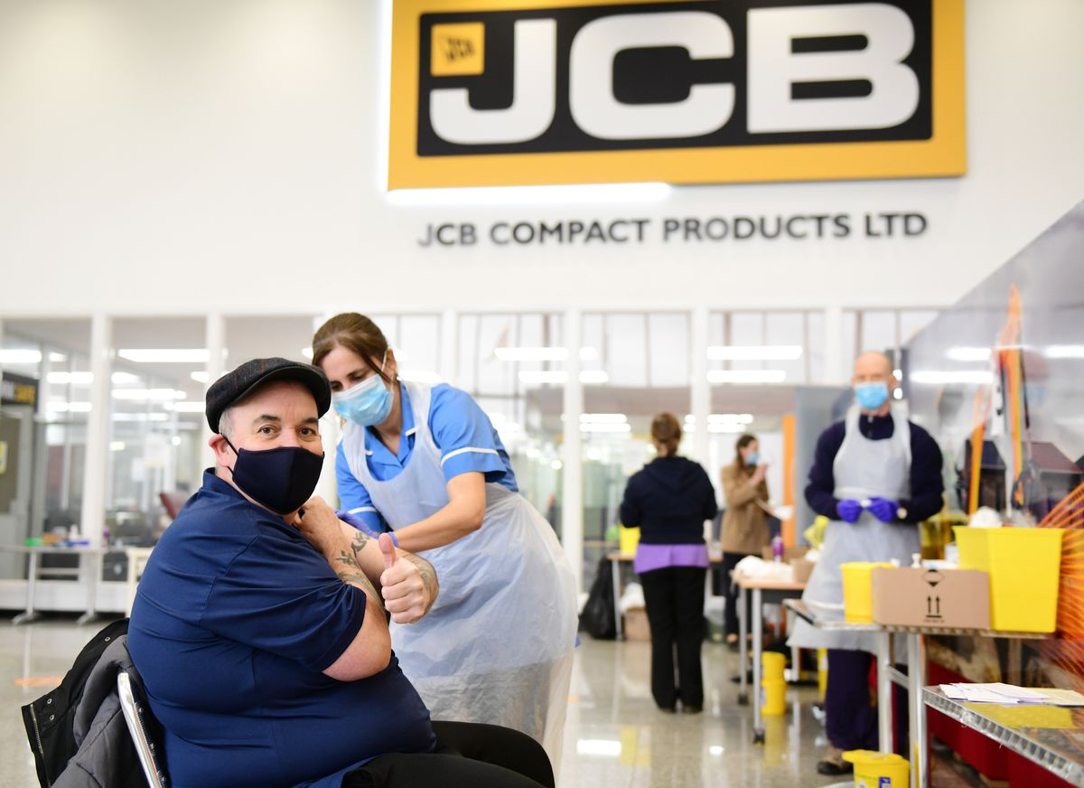 Darts ace Phil Taylor has his jab in the JCB factory