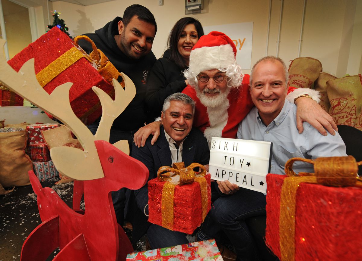 Sikh Toy Appeal founding members Manny Johal, Jaz Sidhu, founding trustee of Promise Dreams Suresh Bawa with Father Christmas and Steve Bull