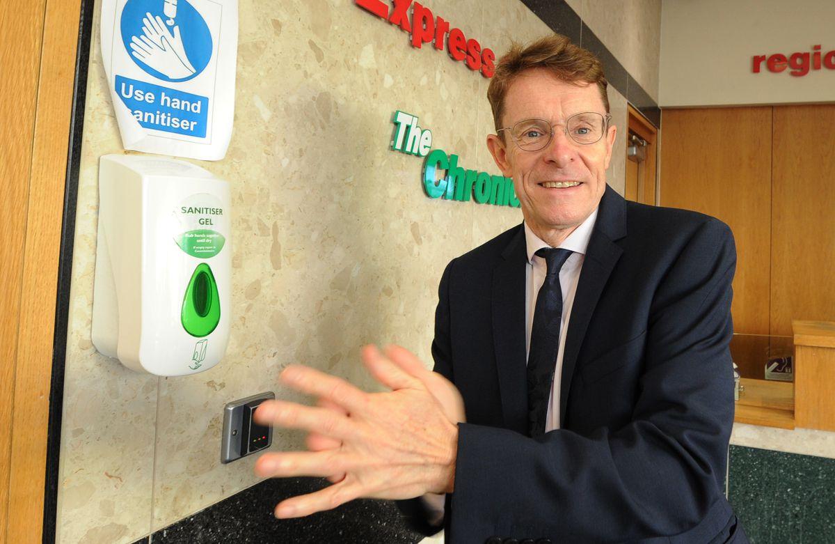 West Midlands Mayor Andy Street uses a hand sanitiser