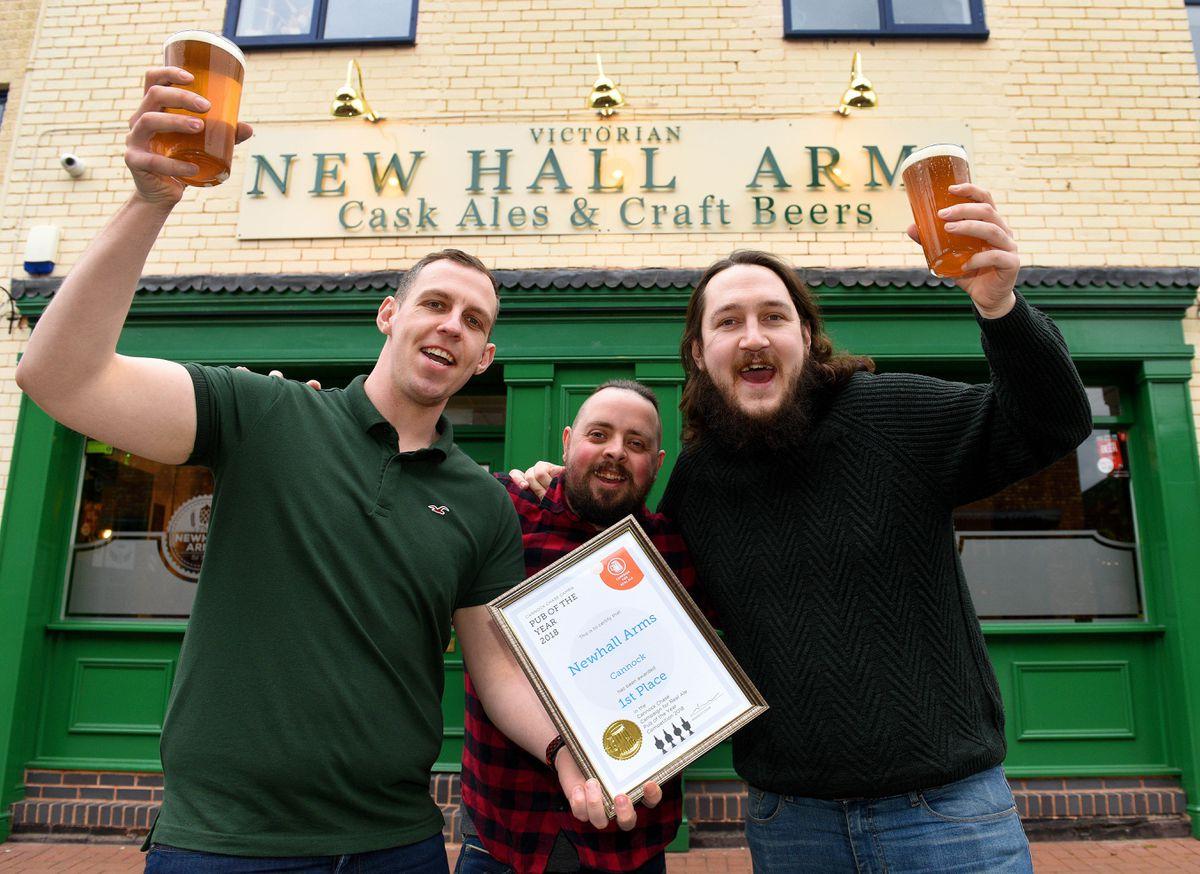 Owners Matt and Jay Ward and head barman Matt Hopley raise a glass to success