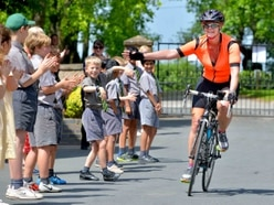 Pupils cheer Alexandra after right royal bike challenge - with video