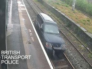 Aaron O'Halloran driving a car on railway tracks between Duddeston and Aston stations in Birmingham