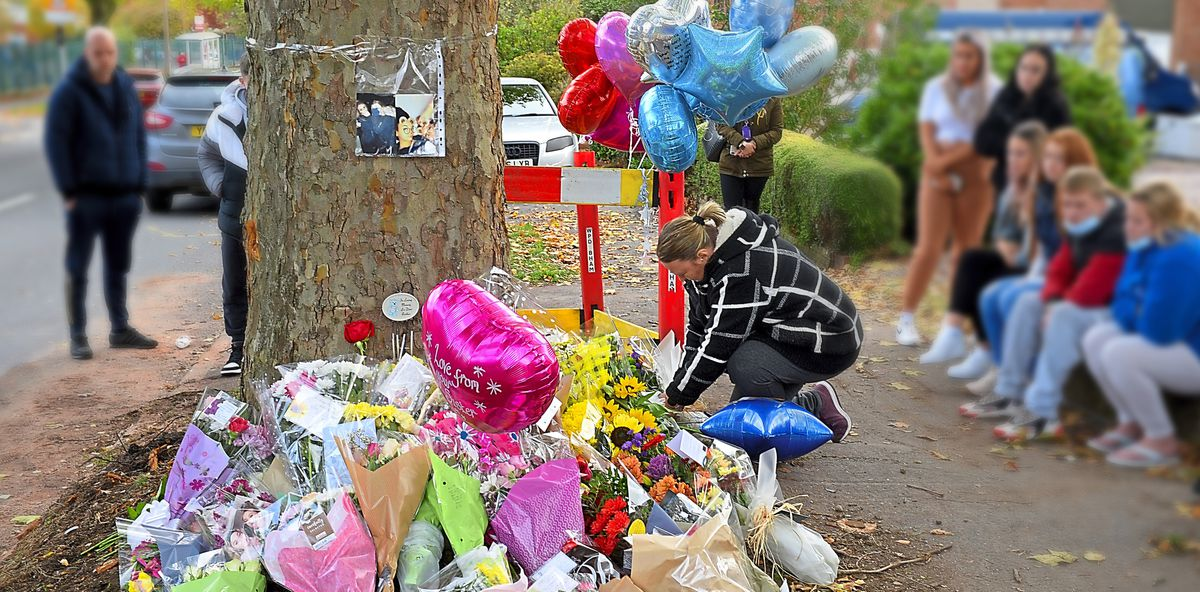 Flowers, balloons and cards have been left at the crash scene