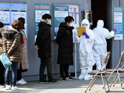 South Korea reports first virus death as 2.5m urged to stay home in city