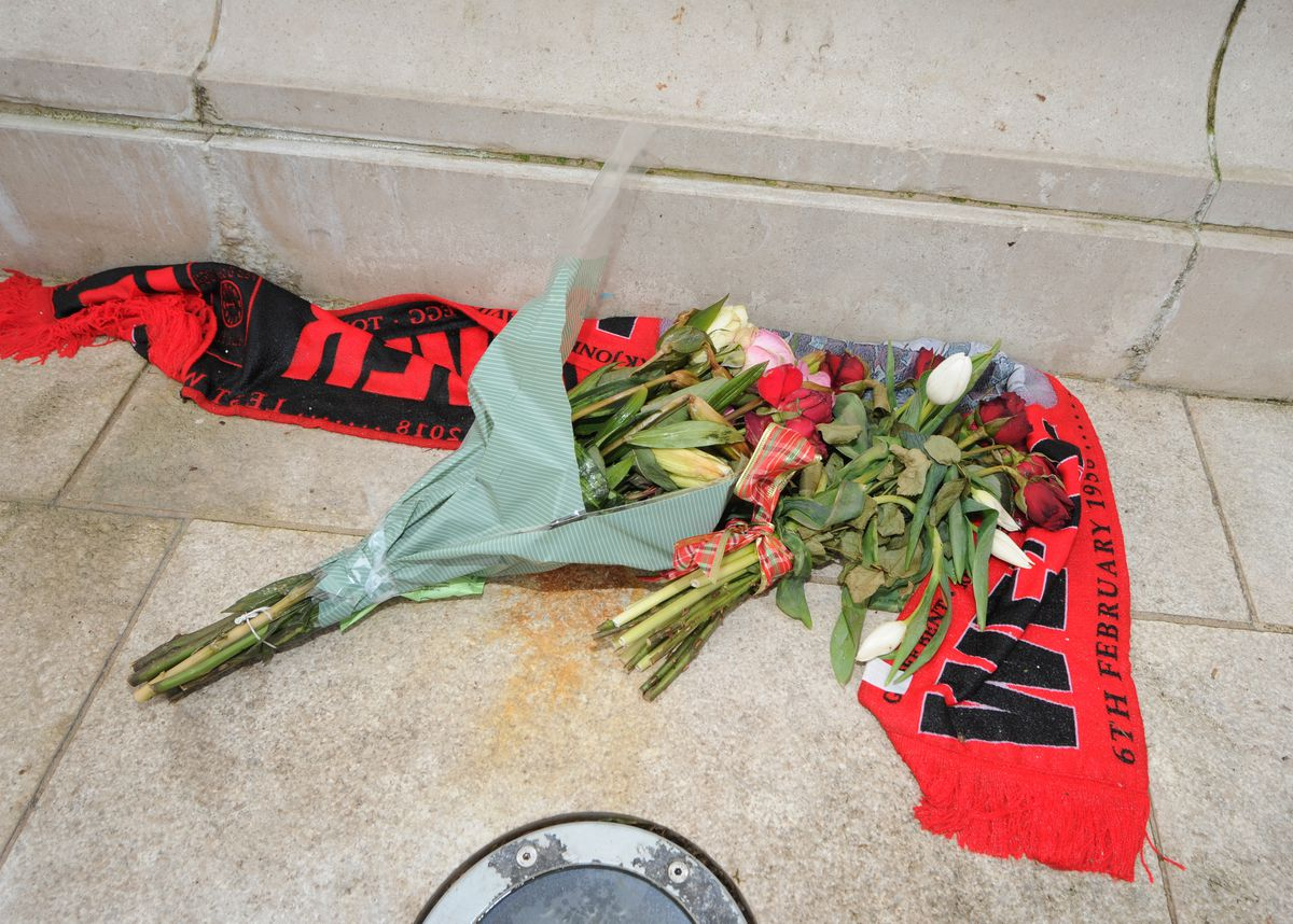 Flowers left in tribute to at the statue of Duncan Edwards