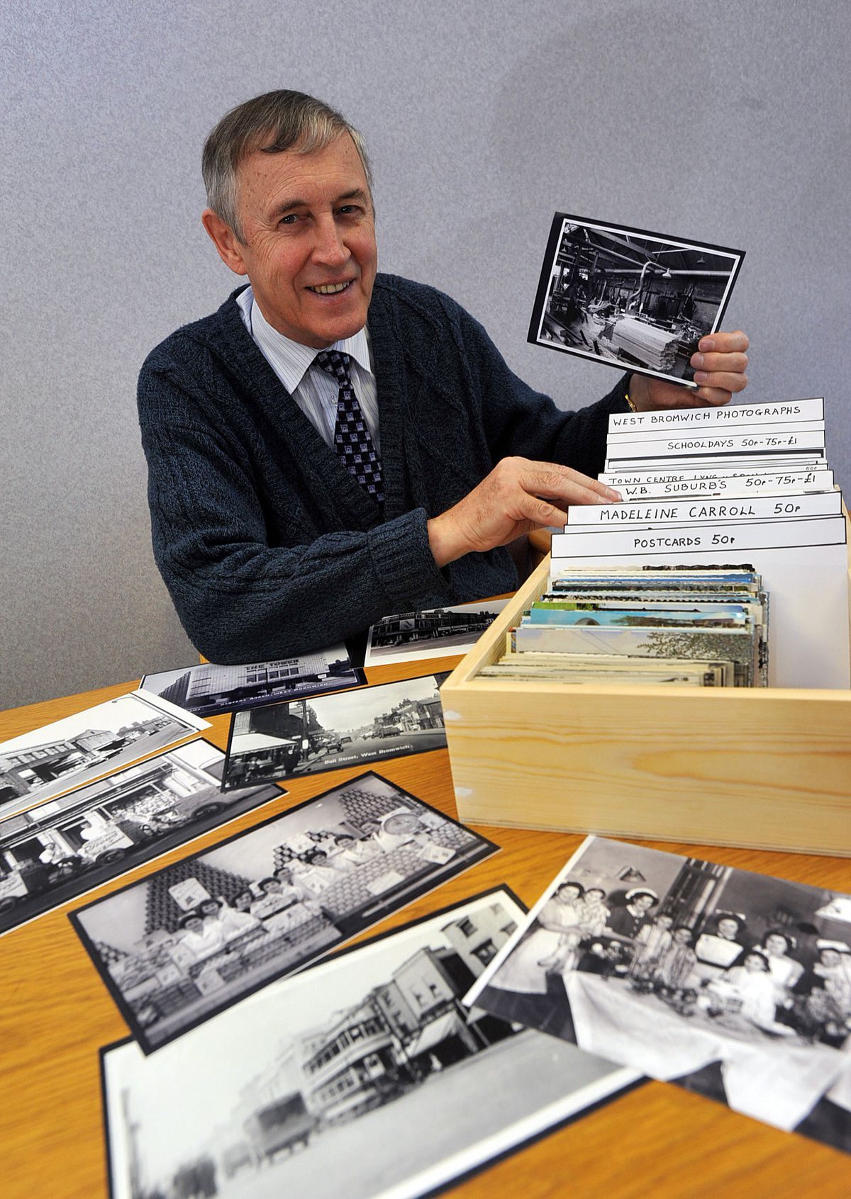 Terry Price with some of his old photographs