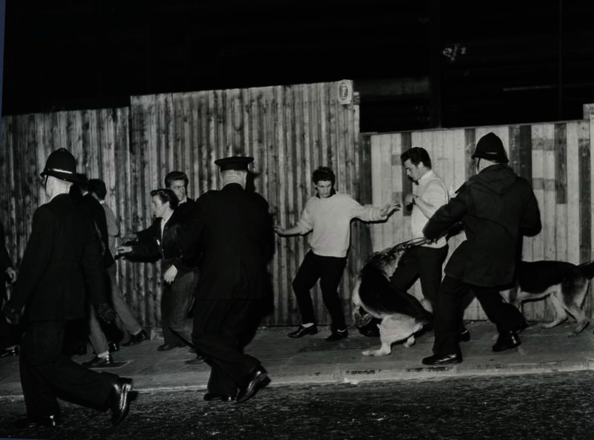 Police and rioters at the corner of Castle Street and Hall Street, Dudley, during 1962 race riots. Photo: Graham Gough
