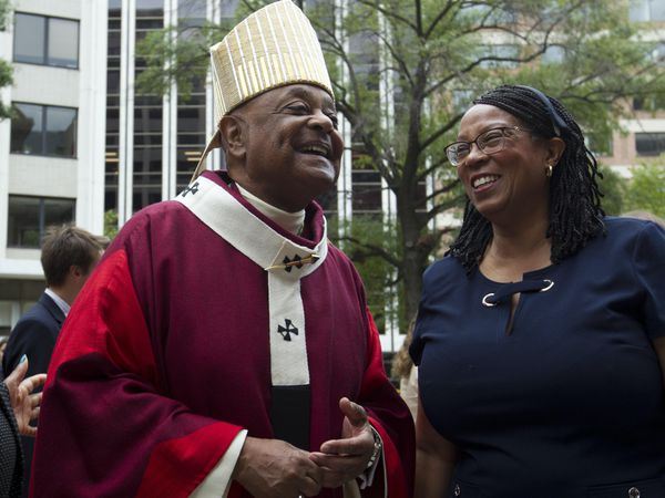 Washington DC Archbishop Wilton Gregory greets churchgoers at St Mathews Cathedral