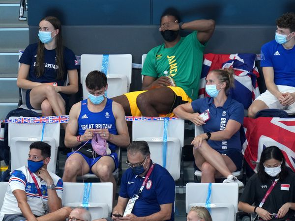 Tom Daley knits in the stands