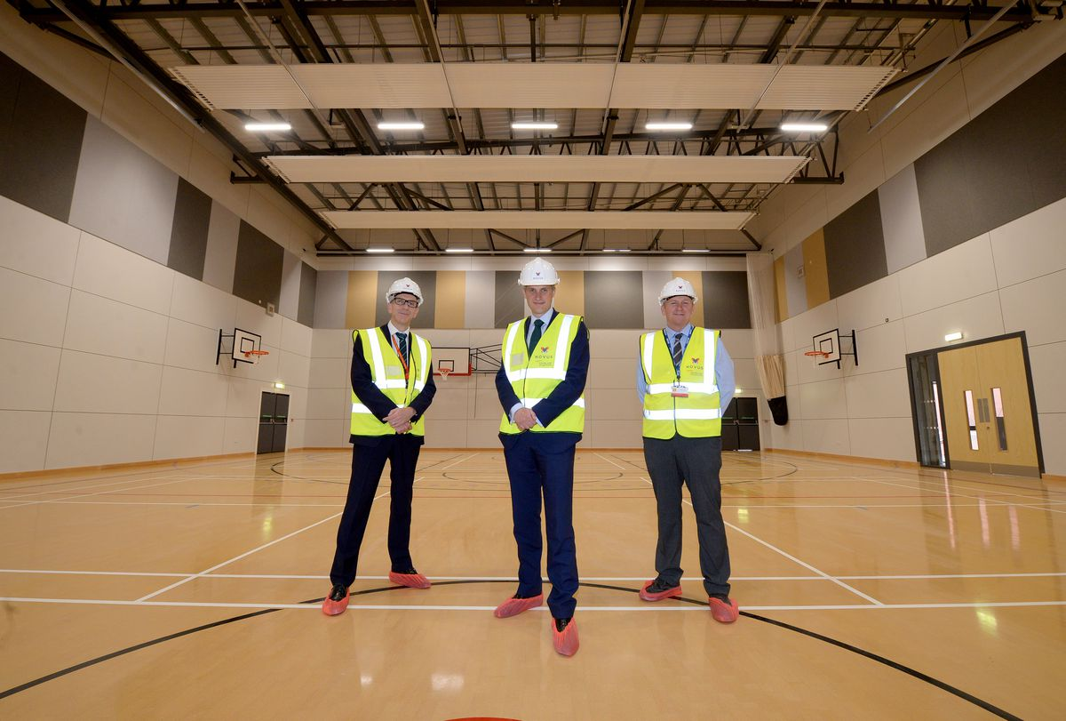 Gavin Williamson with headteacher Glyn Langston-Jones and Ged Carr, contracts manager at Novus, inside the new sports hall