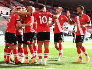 Southampton's James Ward-Prowse (hidden) celebrates scoring