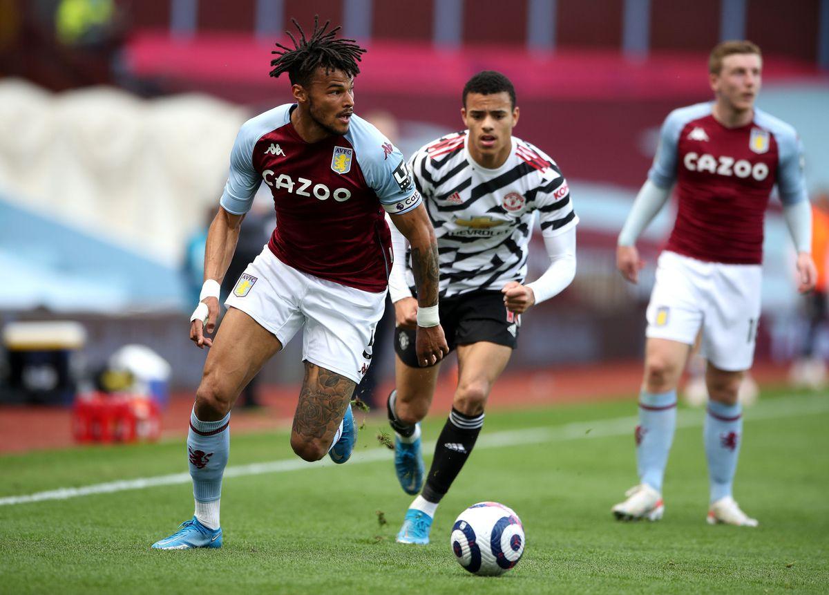 Aston Villa's Bertrand Traore (left) controls the ball