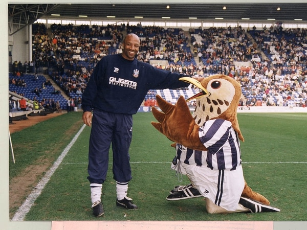 Cyrille Regis: A life on and off the pitch in pictures