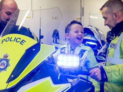Seven-year-old with cancer becomes police officer for a day