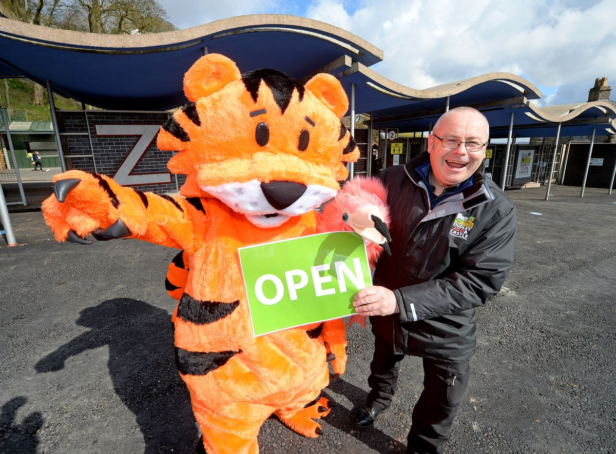 Dudley Zoo and Castle director Derek Grove celebrates reopening with Jambi the zoo mascot