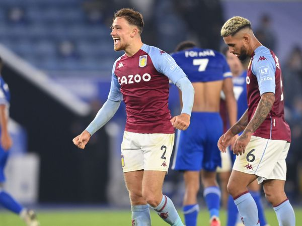 """Aston Villa's Matty Cash (centre) celebrates victory after the Premier League match at the King Power Stadium, Leicester. PA Photo. Picture date: Sunday October 18, 2020. See PA story SOCCER Leicester. Photo credit should read: Michael Regan/PA Wire. RESTRICTIONS: EDITORIAL USE ONLY No use with unauthorised audio, video, data, fixture lists, club/league logos or """"live"""" services. Online in-match use limited to 120 images, no video emulation. No use in betting, games or single club/league/player publications."""