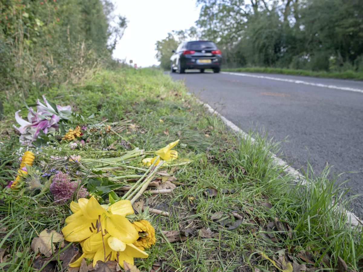 Floral tributes on the B4031 outside RAF Croughton, in Northamptonshire, where Harry Dunn, 19, died when his motorbike was involved in a head-on collision (Steve Parsons/PA)