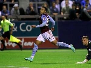 Aston Villa's Cameron Archer (left) scores