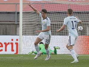 Scotland's Jack Hendry, left, celebrates after scoring his side's opening goal during the international friendly soccer match between the Netherlands and Scotland at the Algarve stadium outside Faro, Portugal, Wednesday June 2, 2021. (AP Photo/Miguel Morenatti).