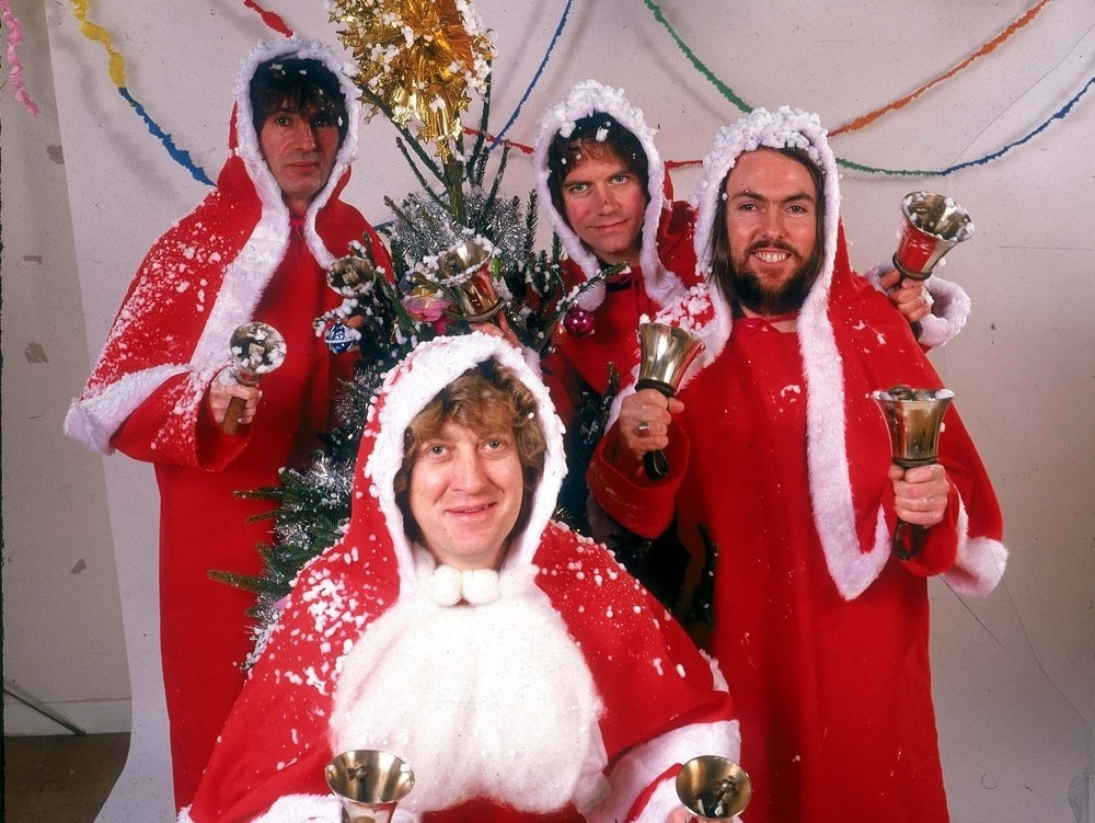 Slade dressed as father Christmas's for their Christmas Number one single Merry Christmas Everybody in 1973