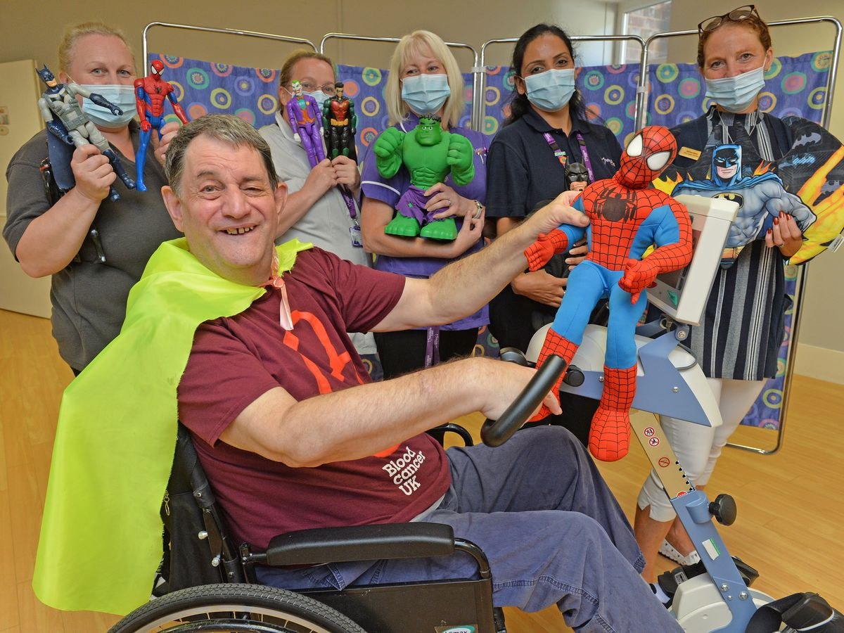 Superhero fan Clive Sayer wants to use his own superpowers to raise money for charity by cycling 100 miles on the exercise bike at St Anthony's Care Home in Wombourne. Clive is pictured with staff from the home, from left: Jane Osborn, Jane Willetts, Sam Farmer, Mamisha Dgra and Melissa Baker