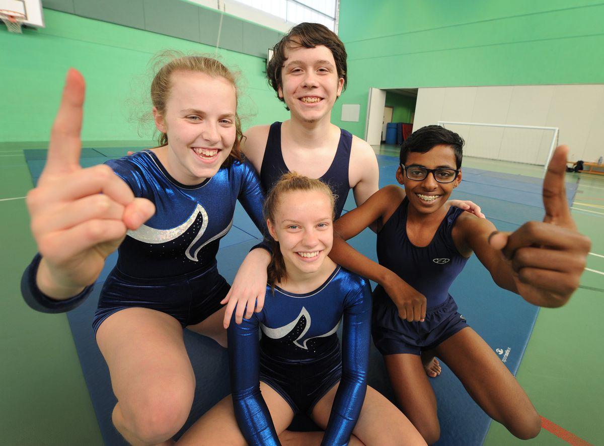 British School National Milano champions, pupils (top) Josh Dodd-Matthews, 15, (left-right) Amelia Beet, 14, Lysia Bayley, 15, and Brientony Jeyarajan, 14, at St Edmund's Catholic Academy, Wolverhampton..