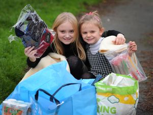 DUDLEY PIC  / DAVID HAMILTON PIC / EXPRESS AND STAR PIC 5/12/20 With some of the items they have collected to give to the homeless, Ruby Gosnell, aged 9, and Emily Maher-Butler, aged 5, of Sedgley..