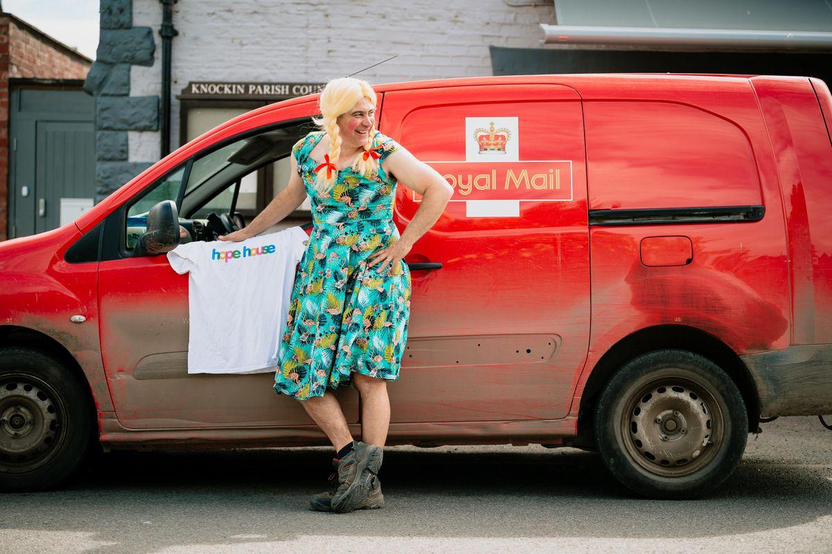 Postman Chris Holgate all dressed to raise money for Hope House
