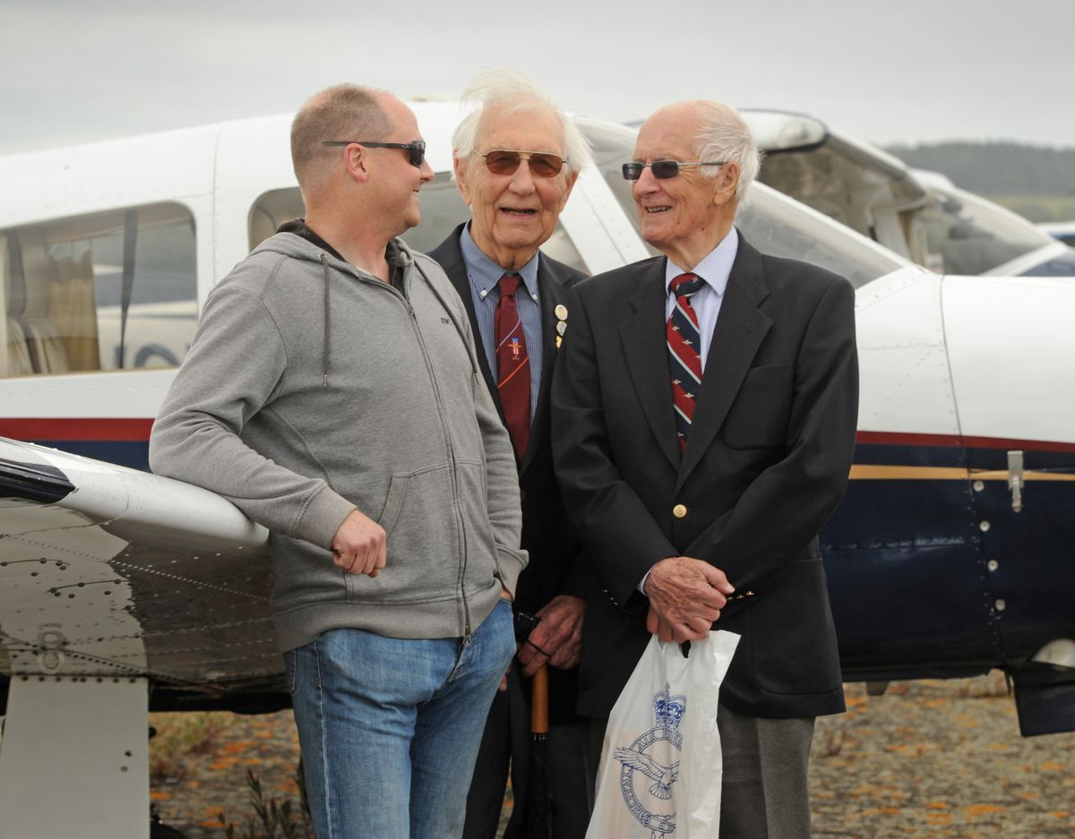 Flying WWII veterans (centre) Mike Igglesden, of Surrey, and (right) William Neilson, aged 94, of Southampton, back home, is pilot (left) Gareth Fearn, of Surrey, following an event at Wolverhampton Halfpenny Green Airport