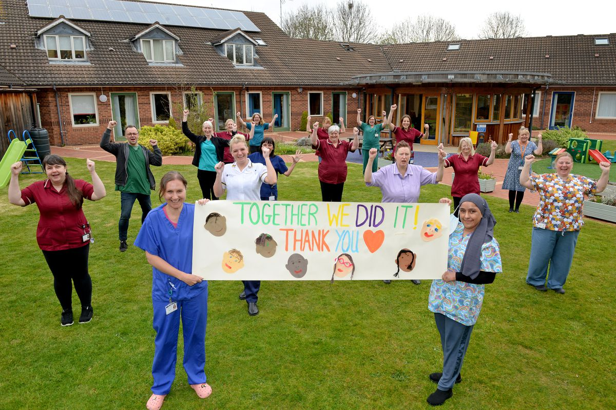 Staff members at Acorns Children's Hospice in Walsall celebrate after the hospice was saved from the threat of closure