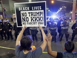 Dramatic pictures show the protests outside Donald Trump's rally in Phoenix