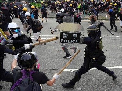 Hong Kong police fire tear gas at demonstrators amid chaotic scenes