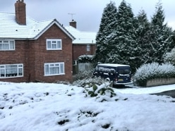 Snow falls amid weather warnings and plunging temperatures