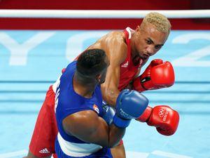 Cuba's Arlen Lopez (left) and Great Britain's Benjamin Whittaker in the Men's Light Heavy (75-81kg) Final Bout