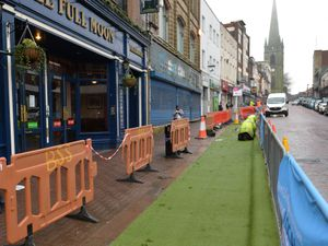 Artificial grass being laid in parking bays in Dudley High Street to aid with social distancing