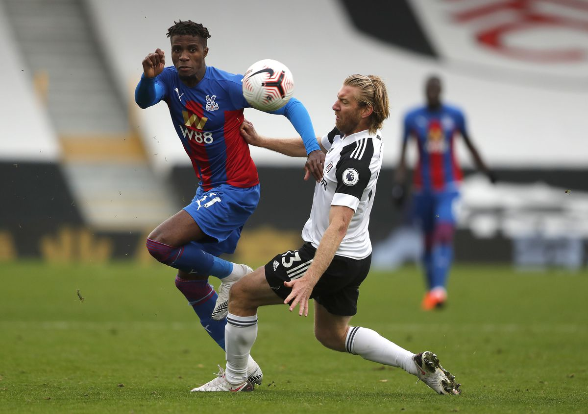 Crystal Palace's Wilfried Zaha (left) and Fulham's Tim Ream