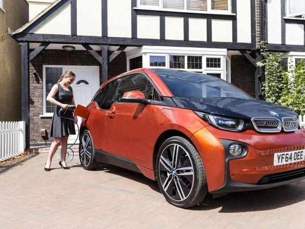 How do I get an electric car charging point installed at home?