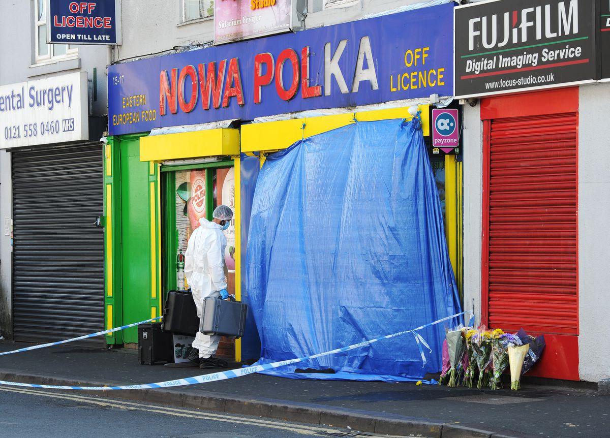 Police at Nowa Polka, Waterloo Road, where Derlarno was stabbed