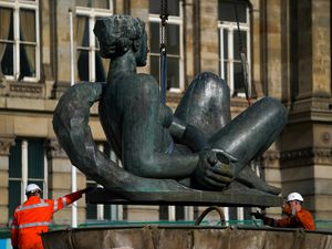 The 'Floozie in the Jacuzzi' is lifted out of its fountain in Victoria Square