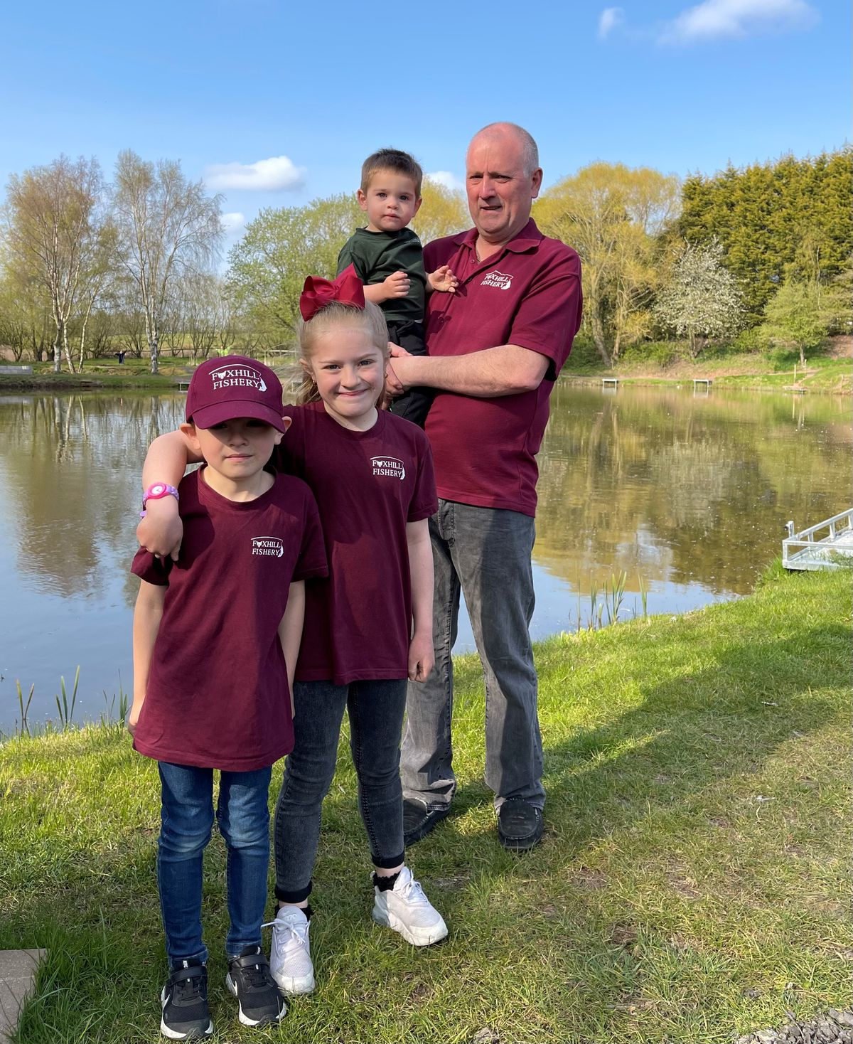 Darren Norris at Foxhills Fishery with some of his family helpers