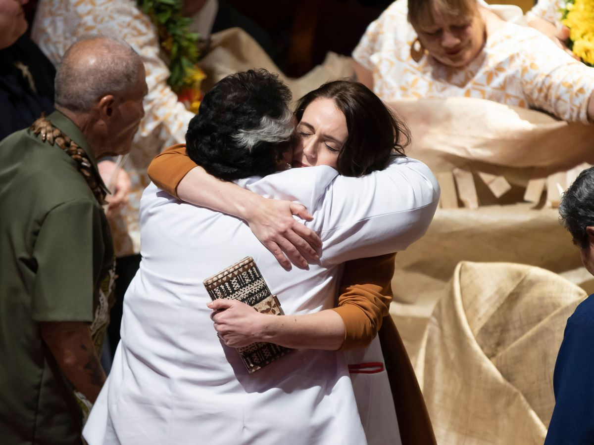 Jacinda Ardern is hugged during a ceremony in Auckland
