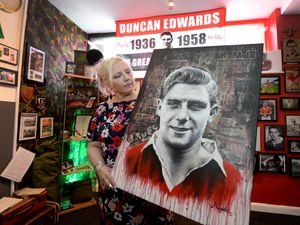 DUDLEY COPYRIGHT MNA MEDIA TIM THURSFIELD 12/06/21 .Founder of the Duncan Edwards Foundation with a specially commissioned piece of artwork which renowned artist Justin Eagleton has painted for the Duncan Edwards museum..