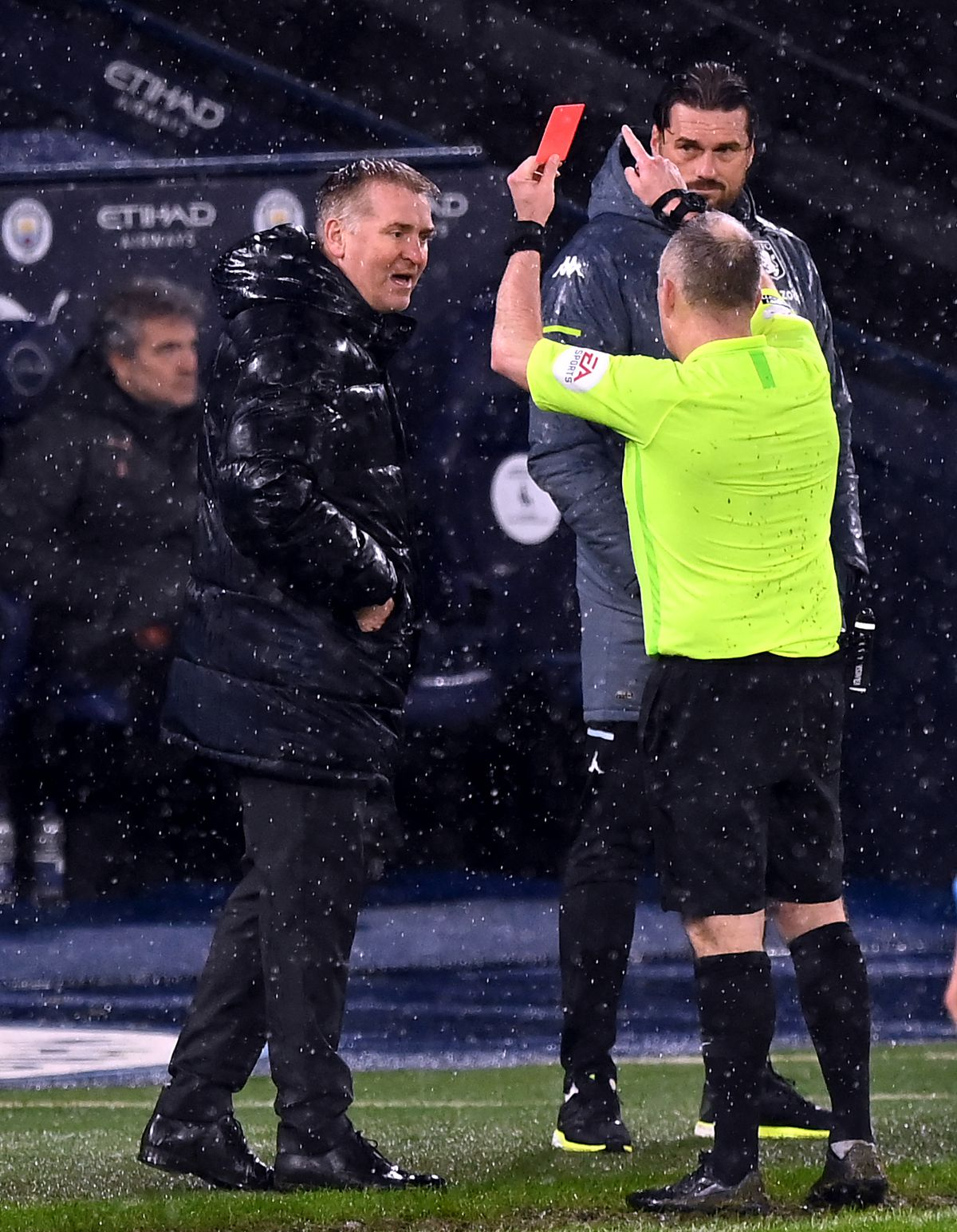 Dean Smith being shown a red card by Referee Jonathan Moss.