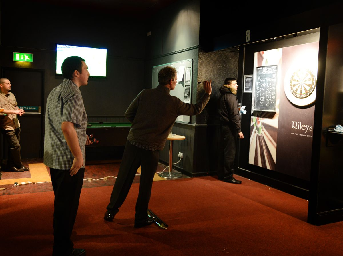A darts open qualifying event taking place at Rileys Sports Bar, Wolverhampton in 2015.