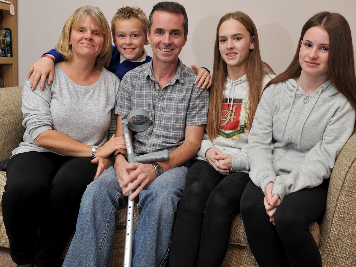 Cardiac arrest survivor Peter Corr, from Trench, with his wife Joanne and children Laurence, Emillia and Isla