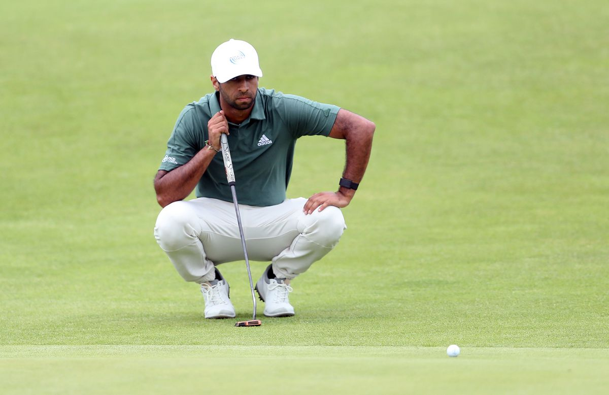 England's Aaron Rai lines up a putt on the 2nd green