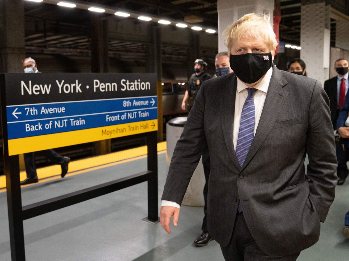 Joe Biden made his climate finance pledge as Boris Johnson travelled on a train to the White House from New York
