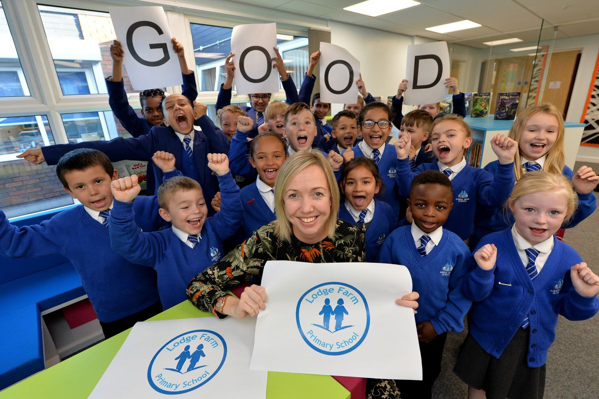 Headteacher Natalie Boys celebrates with the school council following a positive inspection