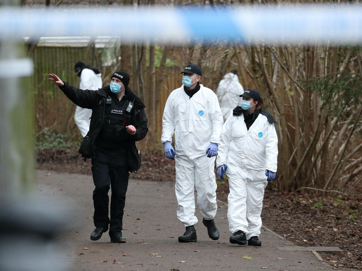 Police searching an alleyway near to where a 13-year-old boy died in Emmer Green, Reading, after being stabbed on Sunday
